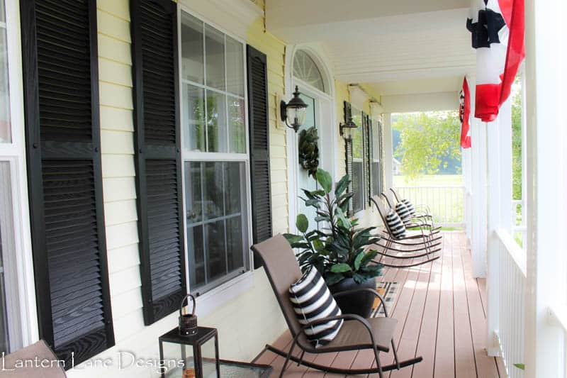 Decorating front porch with paint, new rug, rockers and pillows