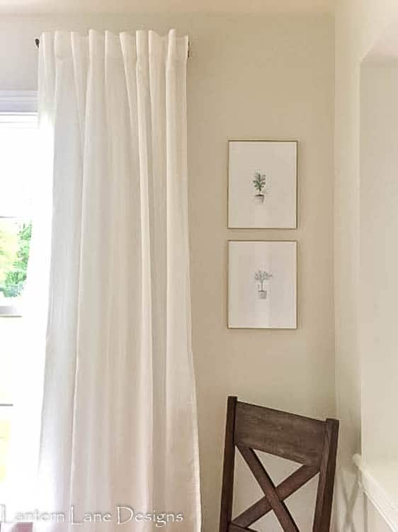 I knew if I tried more 4 letter words were going to come flying out of my mouth so I called this project done and hung all 8 curtain panels this way.