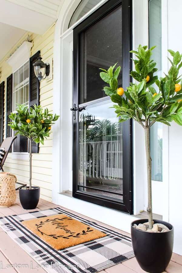 front porch decor with plaid rug