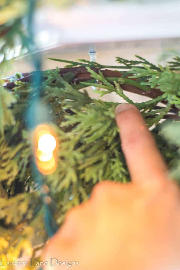 How to hang garland on mantel